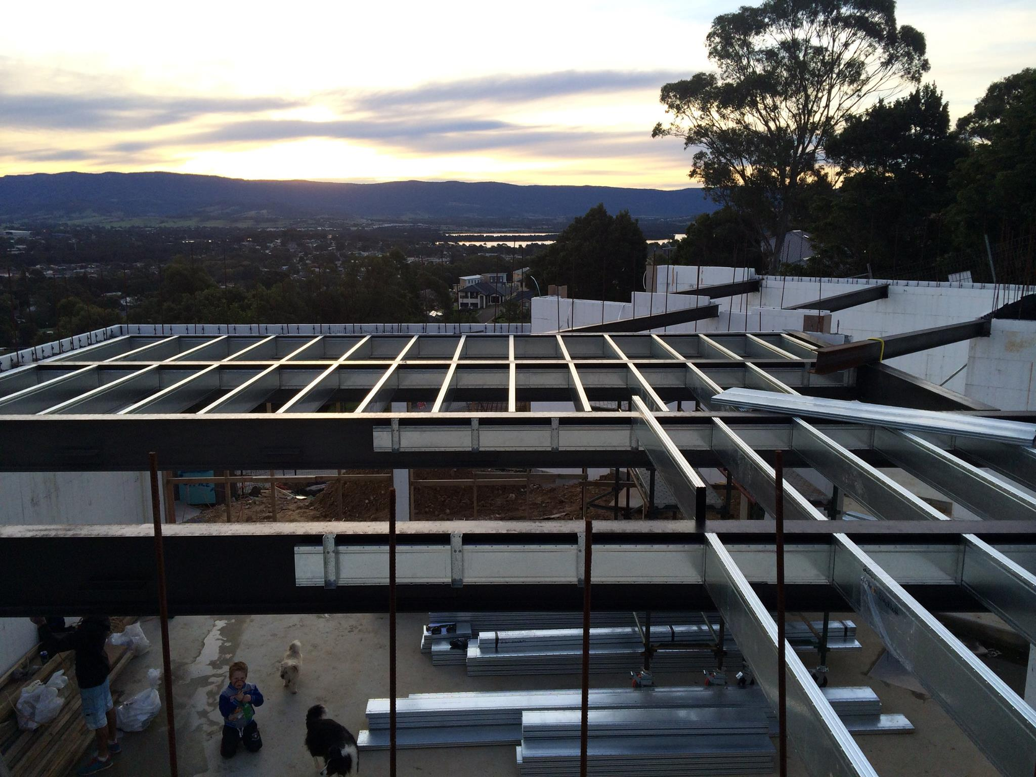 An upper floor frame being built on a sloping site with views of Lake Illawarra, the bearers and joists are to support a smart slab / liteslab floor.