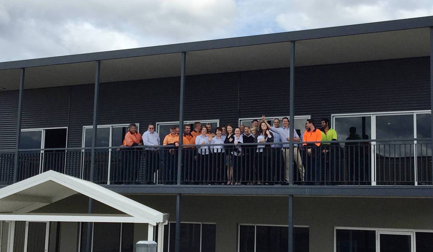 The staff at Spantec line up on the balcony at the Spantec office