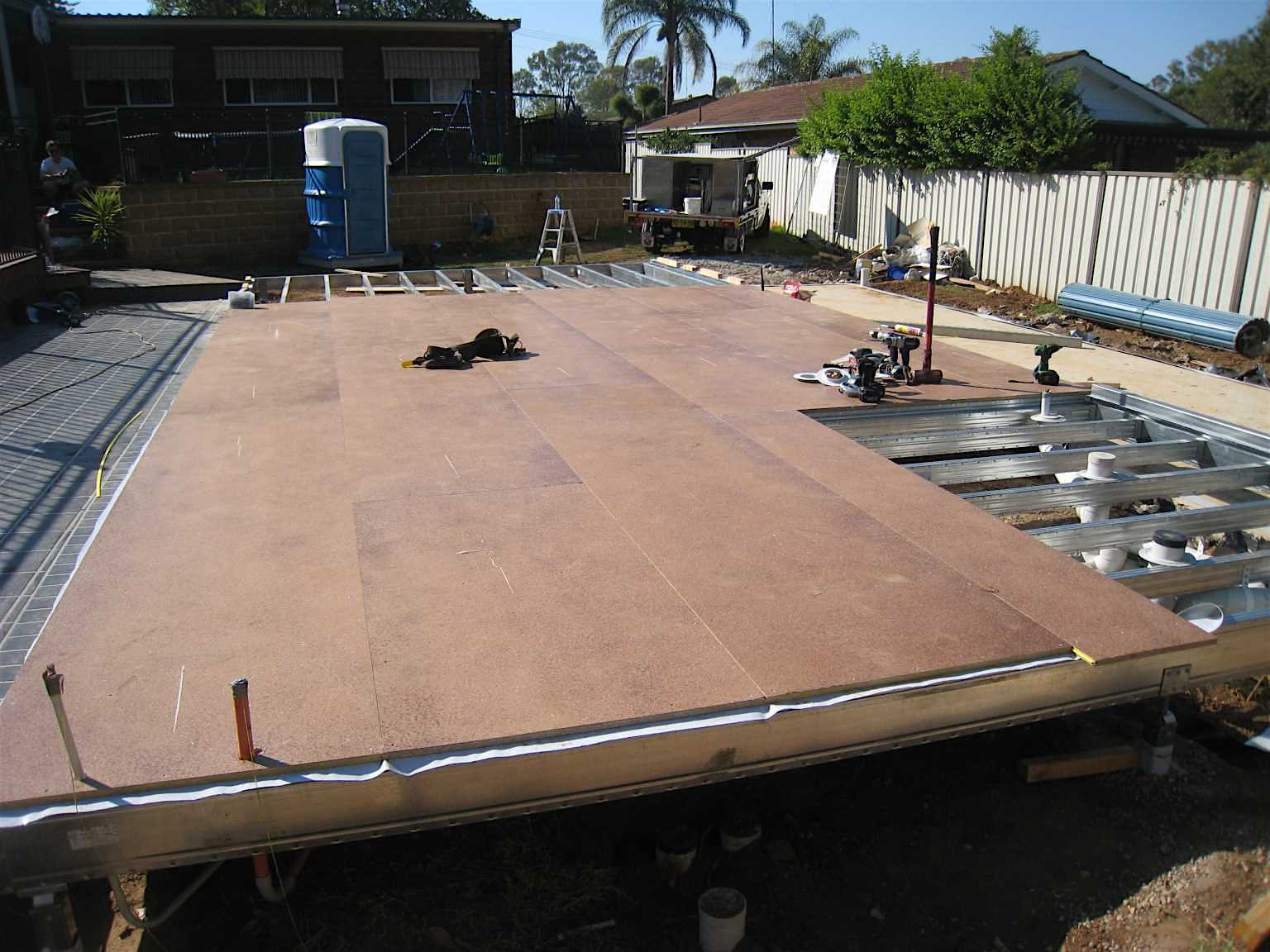 Particle board floor sheeting installation on a Boxspan floor frame