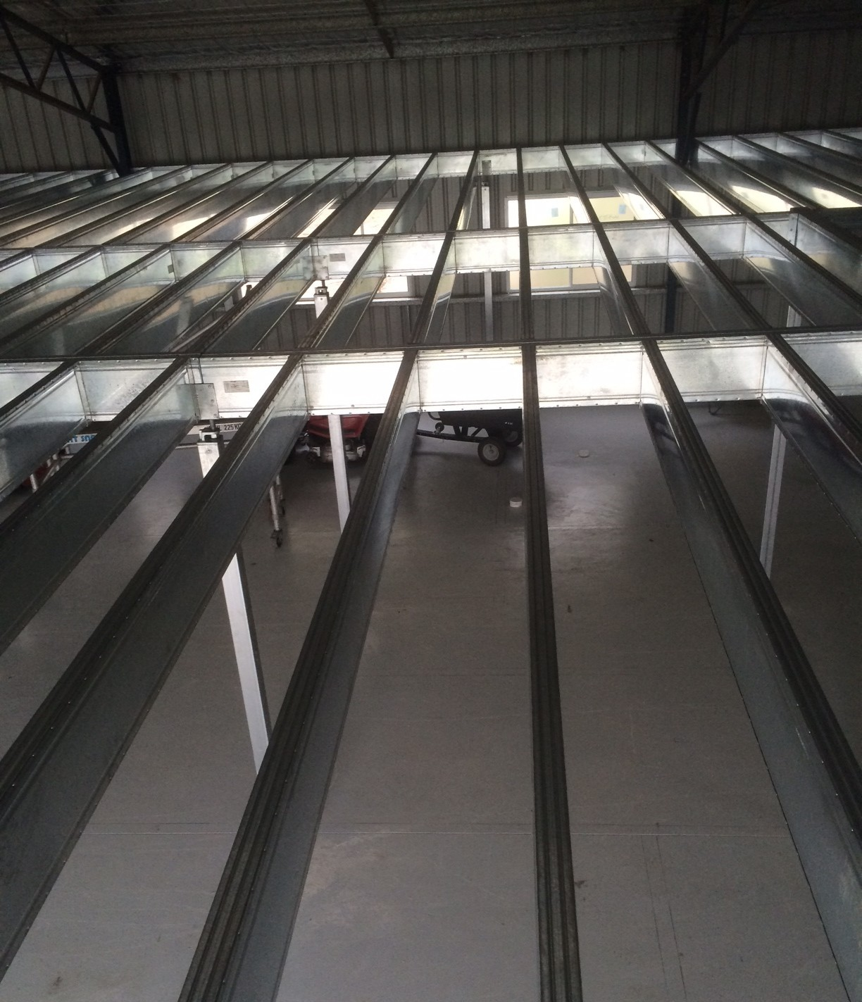 A mezzanine floor in a large shed built from Boxspan bearers and joists