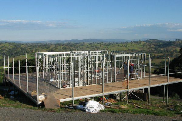 Highset Boxspan floor frame with wrap around verandah on sloping site