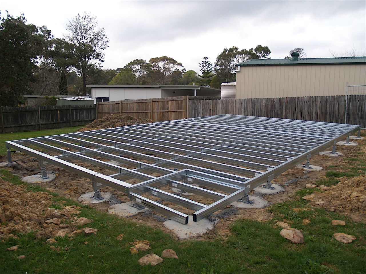 Boxspan steel bearers and joists floor frame for a granny flat in a suburban backyard