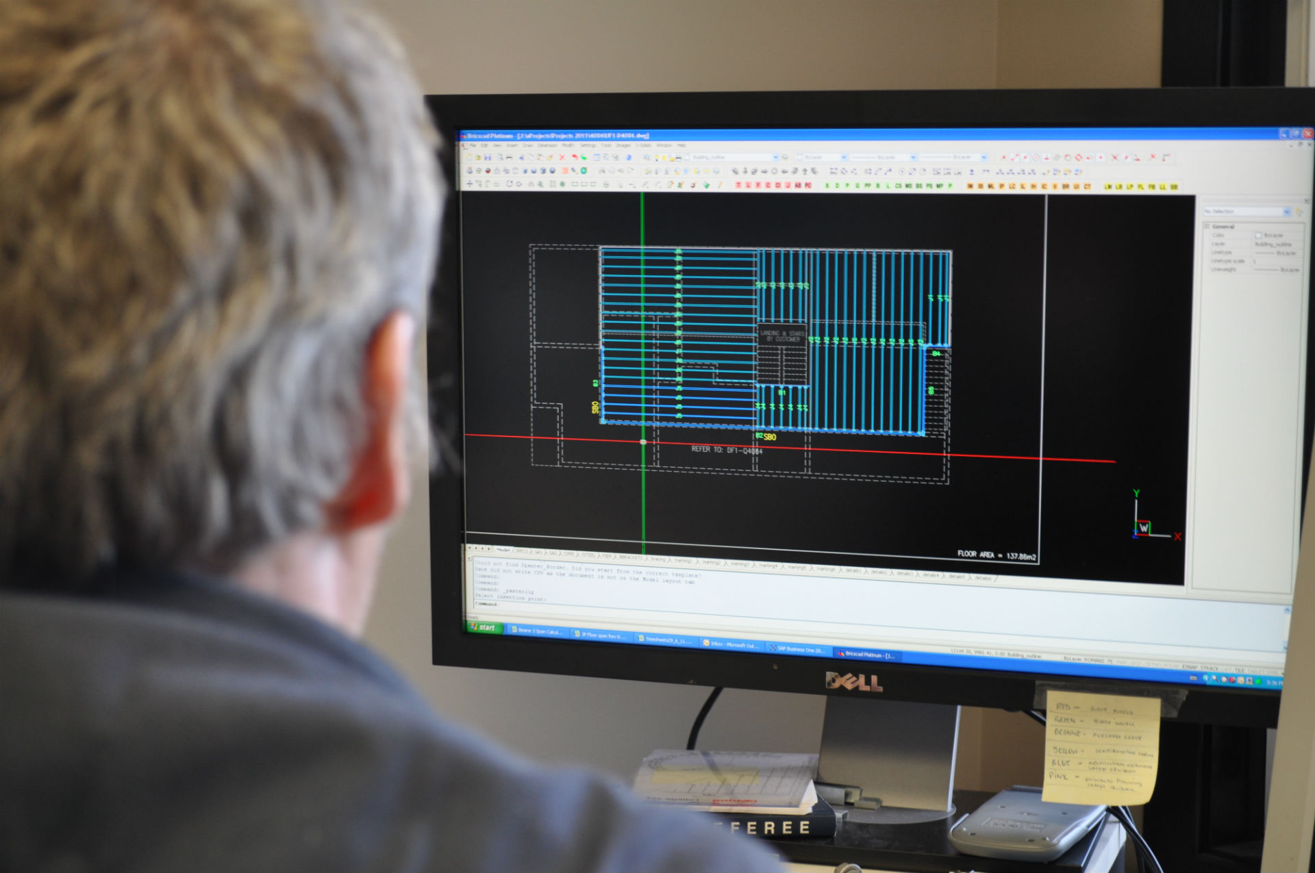 A draftsman uses AutoCAD computer aided drafting software to design a floor frame for a customer.