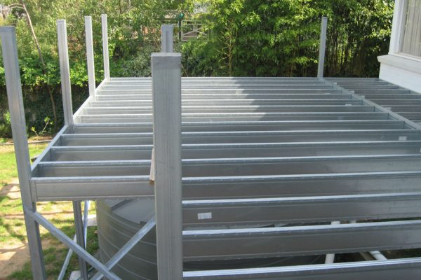 Boxspan steel deck frame over rainwater tank with posts to handrail height