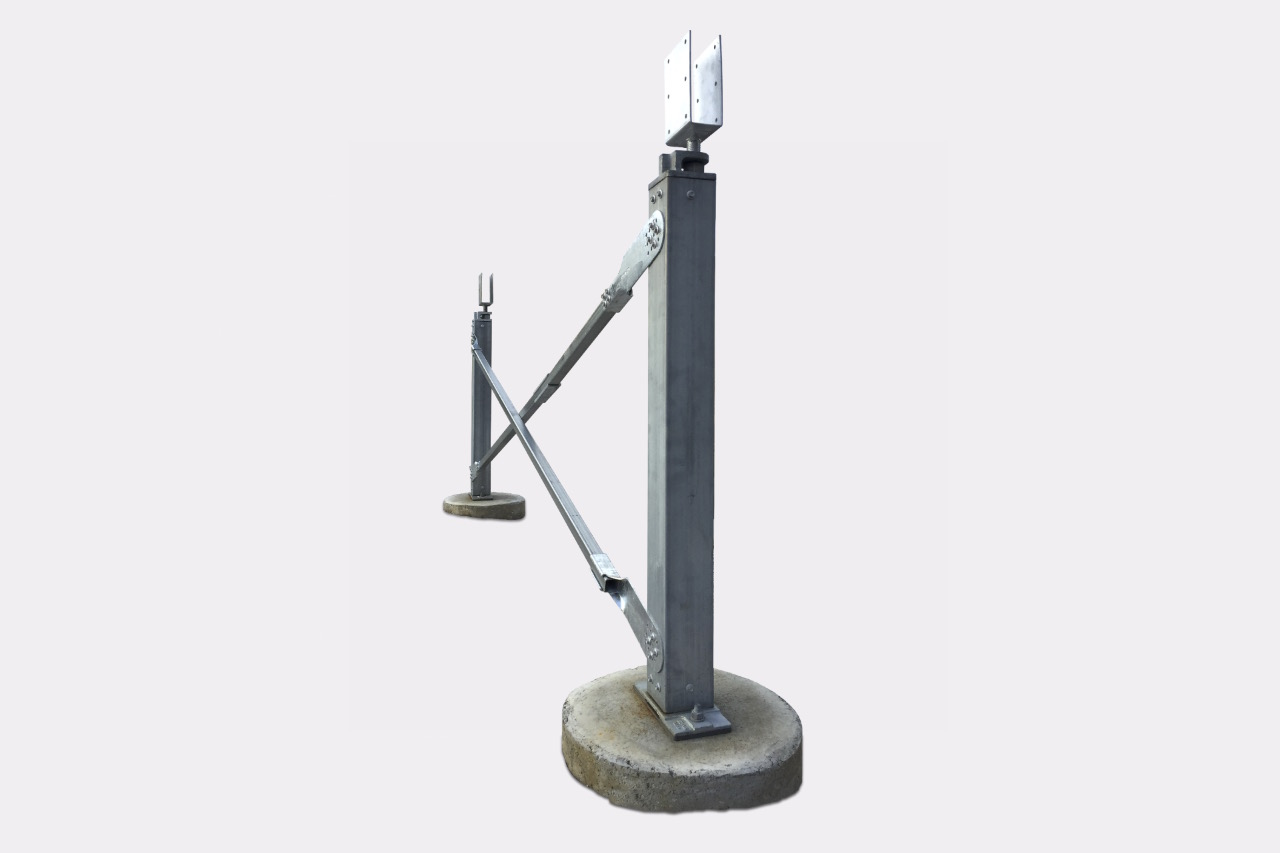 Ezibrace cross bracing and Ezipier Adjustable pier heads above the SHS posts, and Ezipier bases on concrete footings.