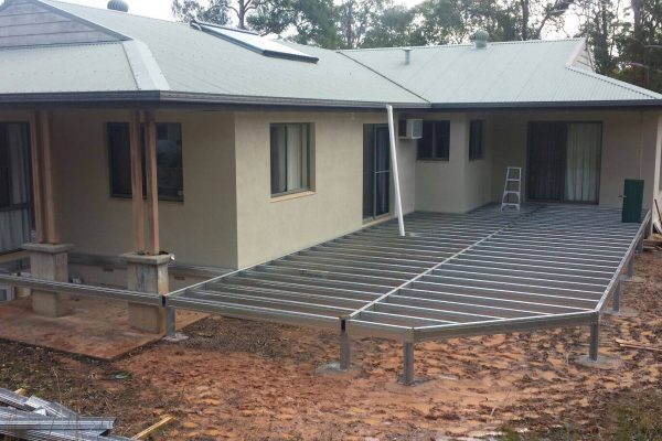 Boxspan deck frame added to existing house increasing the outdoor living space