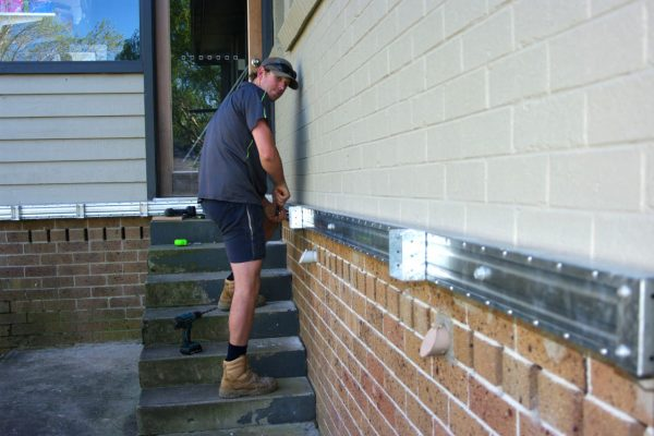 Waling plate installation for deck attachment to existing house