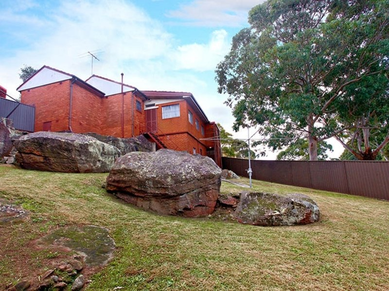 Before photo - tricky sloping site with rock outcrops
