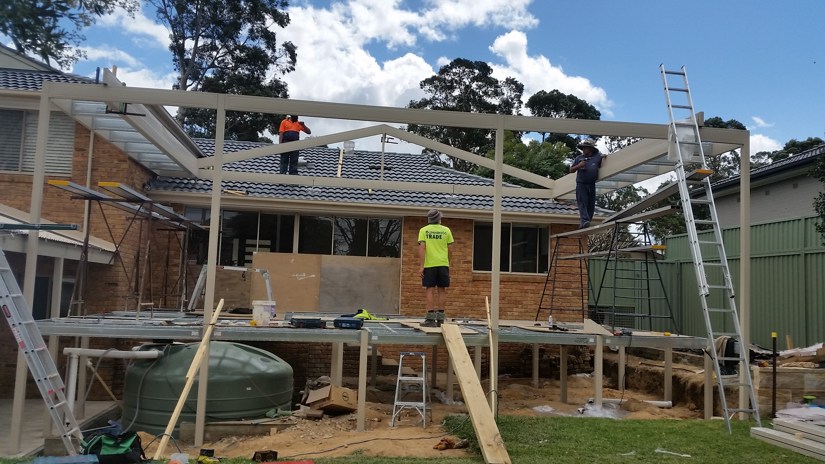 Boxspan deck and pergola frame under construction to existing house
